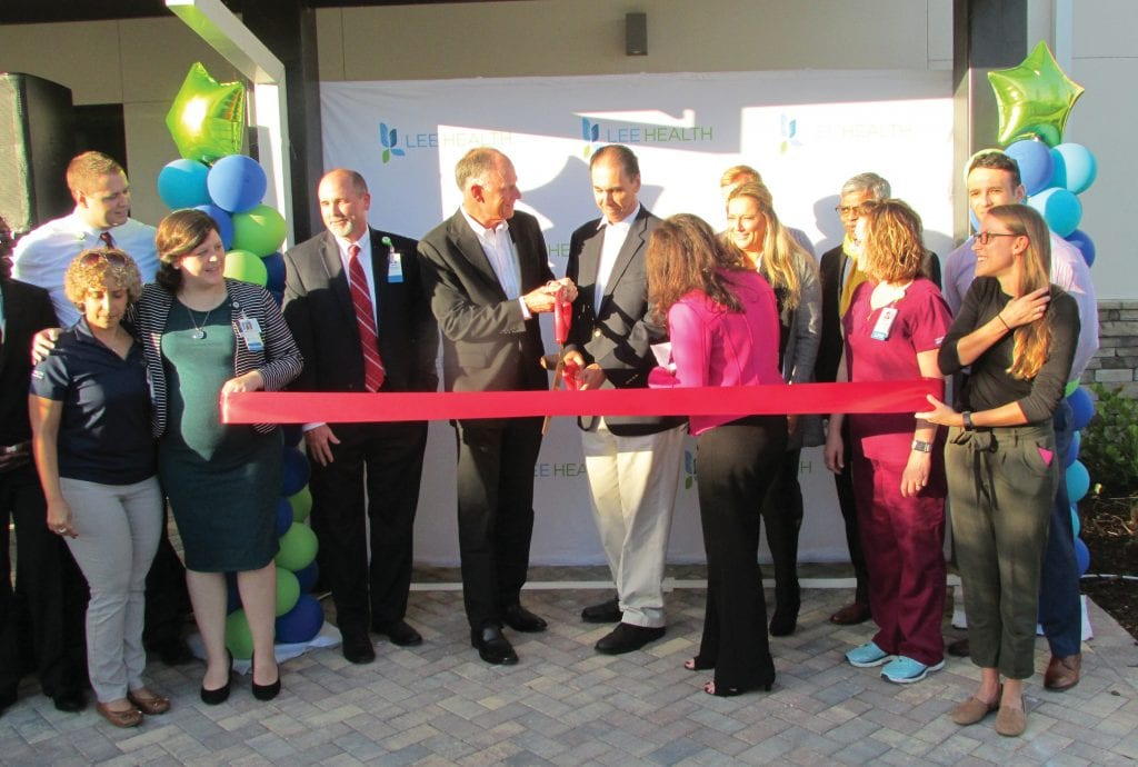 Syd Kitson and Dr. Larry Antonucci cut the ribbon at the opening of the Lee Physician Group primary care clinic at Babcock Ranch. VANDY MAJOR / BABCOCK RANCH TELEGRAPH